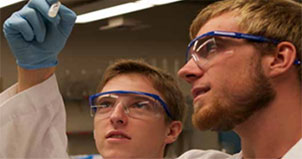 Brothers looking at test tube during demo